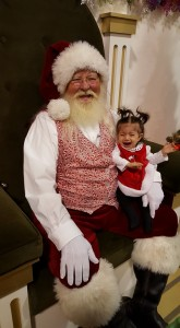 crying baby sitting in santa's lap